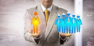 Man Balancing Female Manager Versus Worker Group. Unrecognizable manager balancing a female white collar manager versus a group of five blue collar workers Stock Images