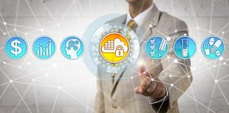 Manager Initiating Compliant Cloud Application. Unrecognizable manager initiating compliant cloud app to unify regulatory, quality and clinical processes. Life Royalty Free Stock Images