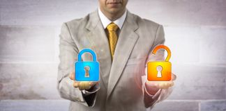 IT Manager Showing A Locked And An Open Padlock stock photography