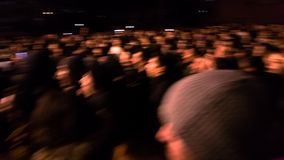 Abtract and blurry view of unrecognizable mass of people on the stock photo