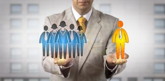 Mediator Balancing Male Leader Versus Work Team. Unrecognizable mediator presenting a work team in one hand and a team leader the other. Business concept for Royalty Free Stock Images