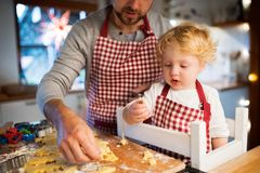 Young family making cookies at home. Stock Images