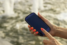 Unrecognizable mobile phone. Blurred background. stock images