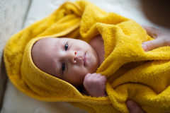 Unrecognizable mother drying her son with towel after bathing hi Stock Photography