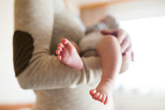 Unrecognizable mother with newborn baby son, legs and hands Stock Photo