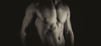 Unrecognizable muscular male body. Black and white Royalty Free Stock Photography