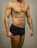 Unrecognizable muscular male body. Stock Photography