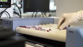 Unrecognizable nurse taking blood samples in machine stock video footage