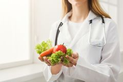 Unrecognizable nutritionist woman with vegetables royalty free stock photography