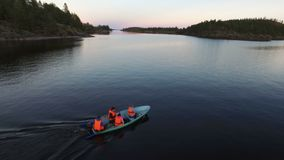 Unrecognizable people in boat at evening aerial. Shot stock video