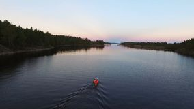Unrecognizable people in boat at evening aerial. Shot stock footage