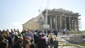 Unrecognizable people large crowd walking Parthenon monument tilt-shift