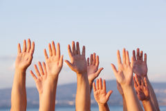 Unrecognizable people pulling hands in the air Royalty Free Stock Image