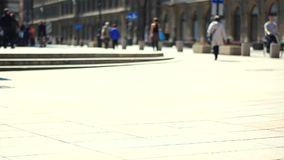 Unrecognizable people on the street. Out of focus scene of people walking on the sidewalk. Unrecognizable people on the street stock video