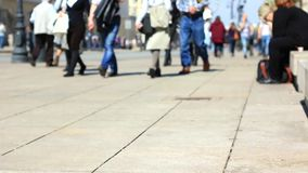 Unrecognizable people on the street. Out of focus scene of people walking on the sidewalk. Unrecognizable people on the street stock footage
