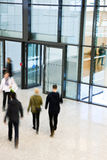 Unrecognizable People Walking in Modern Corridor, Motion Blur Stock Photo