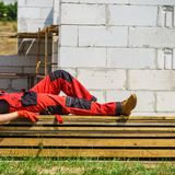Person wearing red worker trousers royalty free stock photo