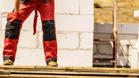Person wearing red worker trousers royalty free stock photography