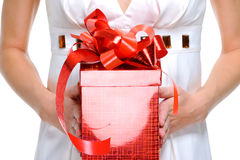 Unrecognizable  person holding the red  gift box. Unrecognizable female person holding the red  gift box - isolated on  white Stock Image