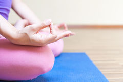 Unrecognizable person meditating and doing yoga exercise indoor Stock Photography