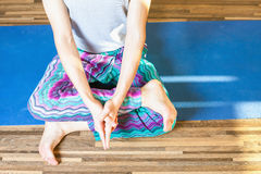 Unrecognizable person meditating and doing yoga exercise indoor Stock Images