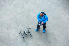 The unrecognizable person, pilot of the drone with the control p royalty free stock image