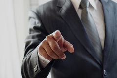 Unrecognizable person pointing with his index finger. Royalty Free Stock Images