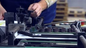 Employee works at print house stock footage