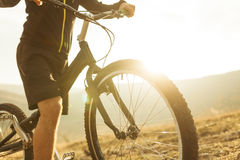 Unrecognizable person on trial bike Stock Photos