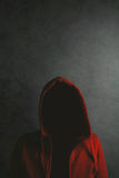 Unrecognizable person wearing red hooded shirt Royalty Free Stock Photo
