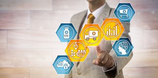 Pharma Logistician Monitoring Supply Chain. Unrecognizable pharmaceutical logistician activating icons for predictive analytics, materials handling and Stock Image