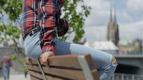 Unrecognizable portrait of a young african american woman wearing checkered shirt, outdoors. Fashion young african woman relaxing in a city, wearing a red stock footage