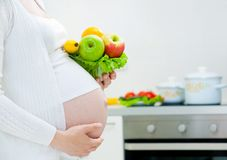 Pregnancy and food Stock Images