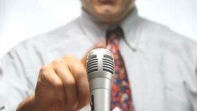 Unrecognizable public speaker. Press conference, microphone and spokesman stock footage