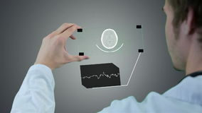 Unrecognizable scientist, doctor hands using futuristic touchscreen technology, showing x-ray. Motion graphic. Professional scientist, doctor using futuristic stock video