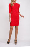 Unrecognizable slender young woman in a red dress royalty free stock images