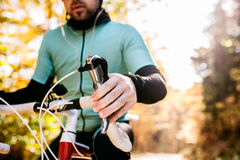 Unrecognizable sportsman riding his bicycle in sunny autumn natu Royalty Free Stock Images