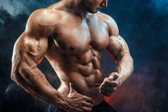 Unrecognizable Strong bodybuilder man with perfect abs, shoulders,biceps, triceps, chest. Unrecognizable Strong bald bodybuilder with six pack. Bodybuilder man royalty free stock images