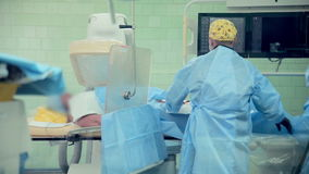 Unrecognizable Surgeons team performing operation in hospital operating room. Surgeon operating patient. 1080p stock footage
