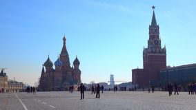 Unrecognizable tourists on Red square in Moscow, Russia. Sunny day 4K shot. Clip stock footage