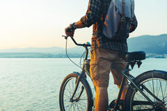 Unrecognizable Traveler Man Standing With Bike On Coast And Enjoying View of Nature Sunset Vacation Traveling Relaxation Resting C Stock Images