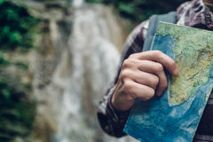 Unrecognizable Traveler Standing With Travel Map In Hand. Hiking Travel Tourism Concept. Man traveler standing with travel map in hand. Hiking Travel Tourism Stock Image