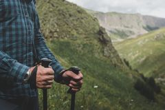Unrecognizable Traveler With Trekking Poles In Hands. Journey Outdoor stock images