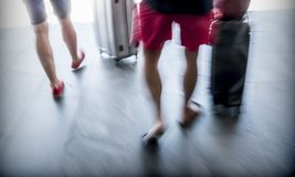 Unrecognizable travellers walking with suitcases, selective blur Royalty Free Stock Photo