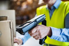 Warehouse woman worker with barcode scanner. Royalty Free Stock Photo