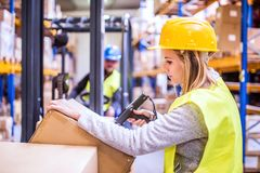 Warehouse woman worker with barcode scanner. Unrecognizable warehouse women worker or supervisor with barcode scanner. A mobile handheld PC with barcode scanner stock photos