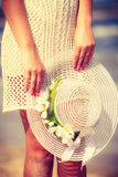 Unrecognizable woman in dress holding sun hat Royalty Free Stock Photos