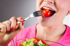 Unrecognizable woman eating salad Royalty Free Stock Images