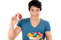 Unrecognizable woman hand holding up for egg knocking a red Easter egg. Royalty Free Stock Photography