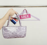 Unrecognizable woman hand shopping with credit cards on sale. Stock Images